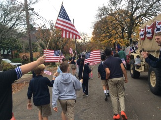The 5th Grade hold their flags high at the Veteran's Day Parade